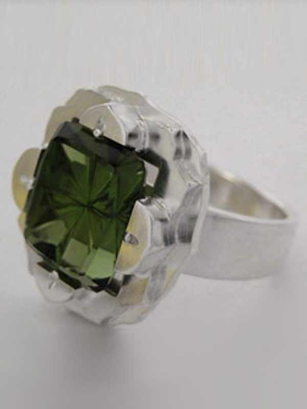 StarBrite™ cut Green Tourmaline By John Dyer & Co.  In a custom Silver ring designed and made by Andy Lucas.