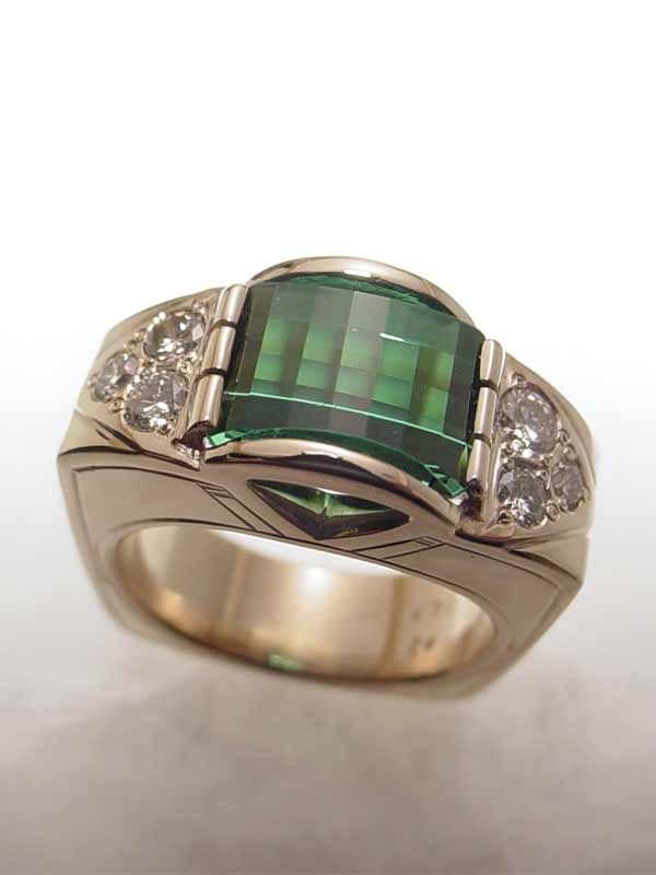 Custom Gold and Diamond ring with a Green Tourmaline in it