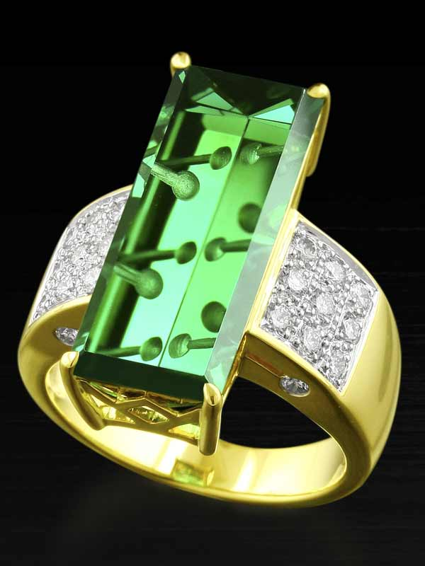 Fantasy cut tourmaline in a designer gold and diamond ring