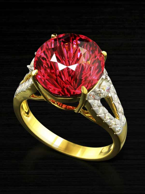 Fantasy cut umbalite garnet in a designer gold and diamond ring