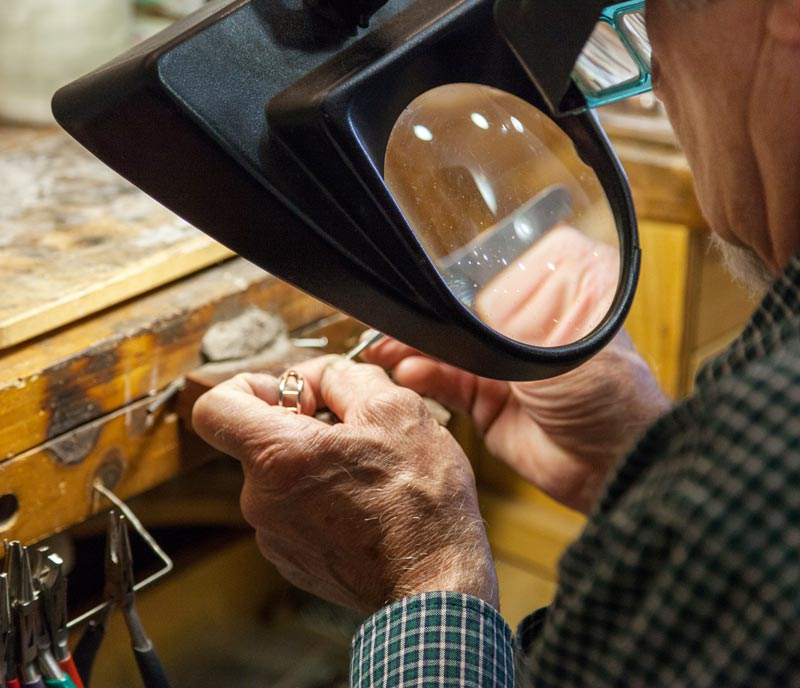 Goldsmith working on a ring at Midwest Jewelers and Estate Buyers